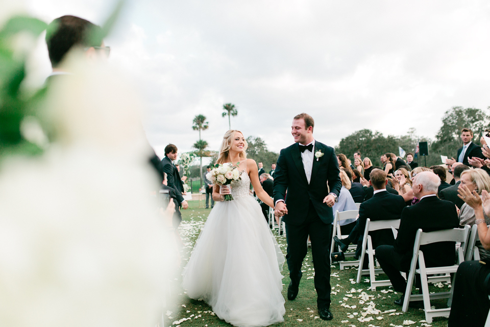 Image of the bride and groom exiting their wedding ceremony at TPC Sawgrass in Ponte Vedra, Florida