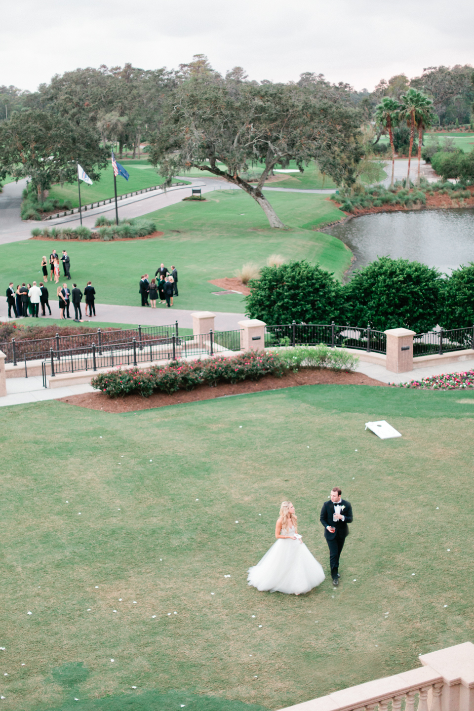 Image of a bride and groom walking the green at TPC Sawgrass in Ponte Vedra, Florida