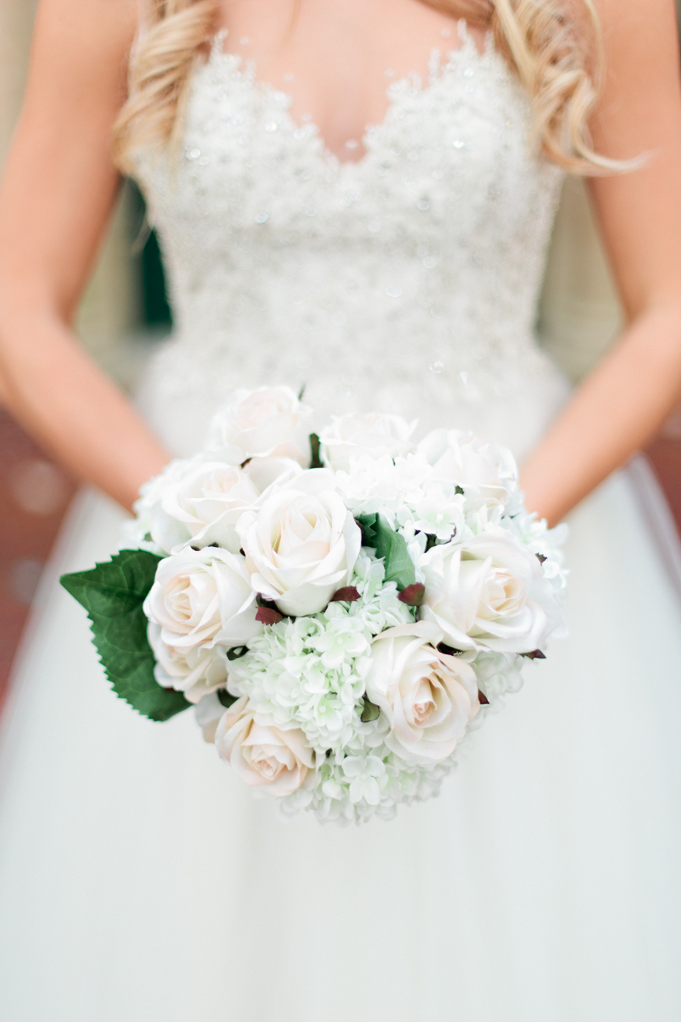 Picture of a bride holding a white bridal bouquet at the Epping Forest Yacht Club in Jacksonville, Florida