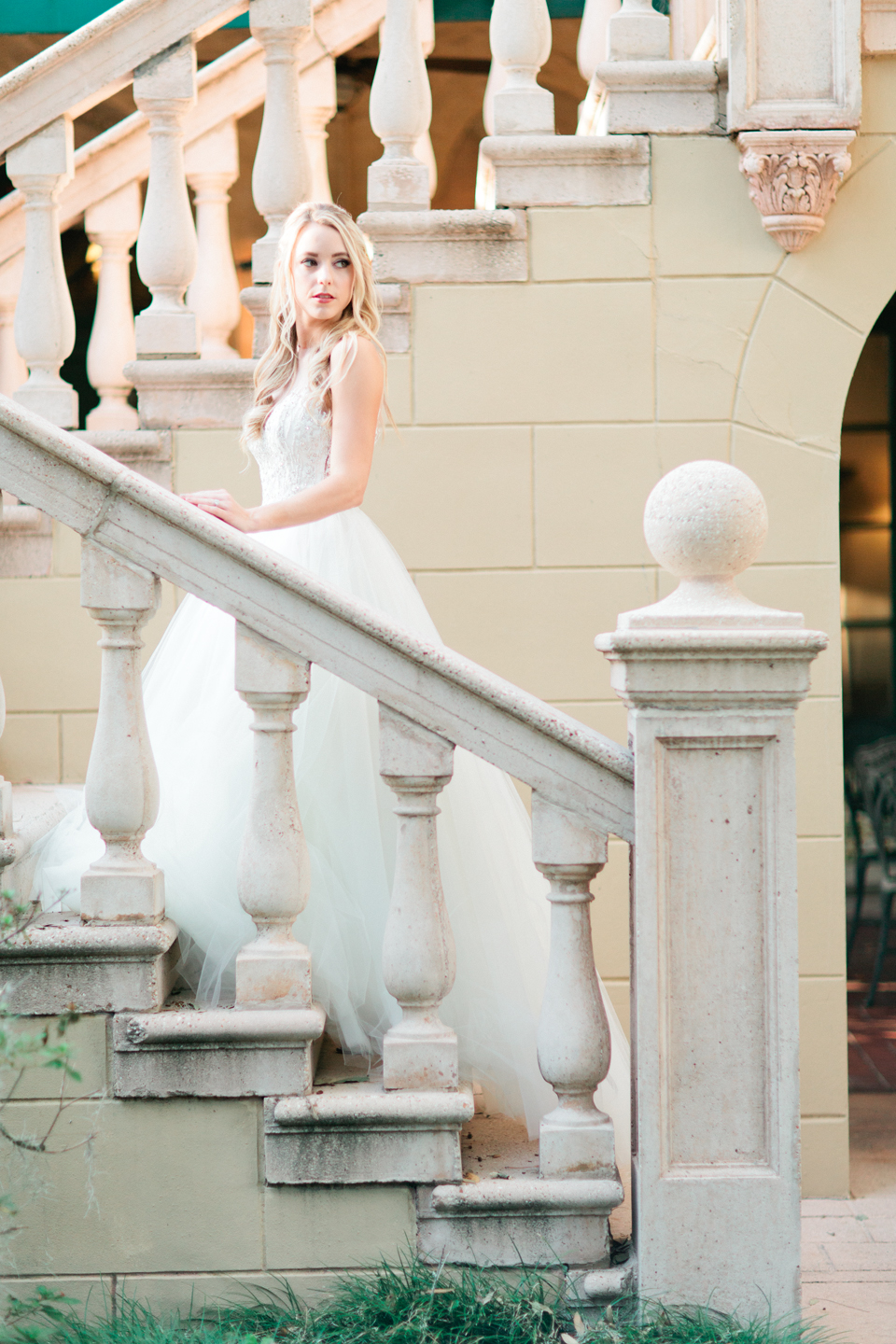 Picture of a bride on the staircase at Epping Forest Yacht Club in Jacksonville, Florida