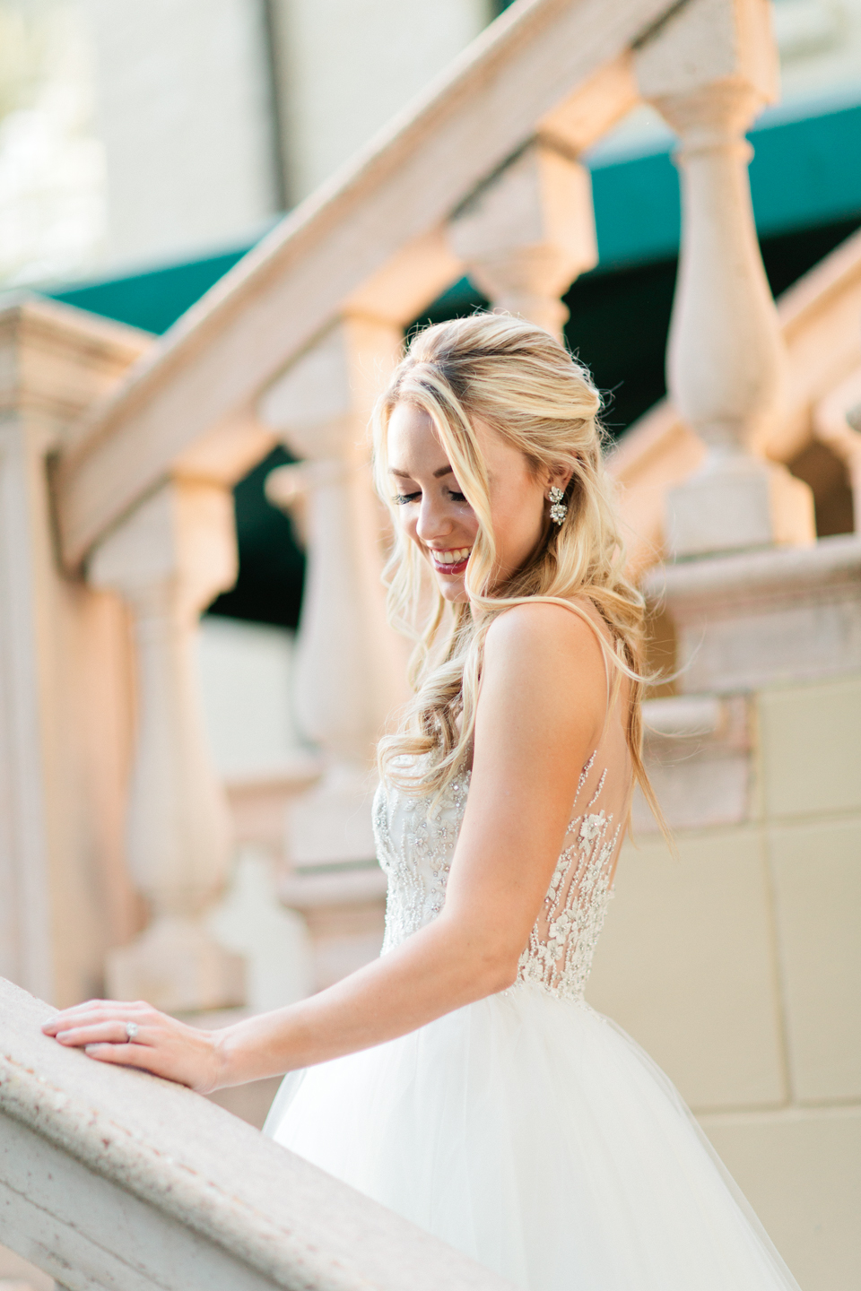 Image of a bride in a wedding Calvet Couture wedding gown at the Epping Forest Yacht Club in Jacksonville Florida.  She is on a staircase.