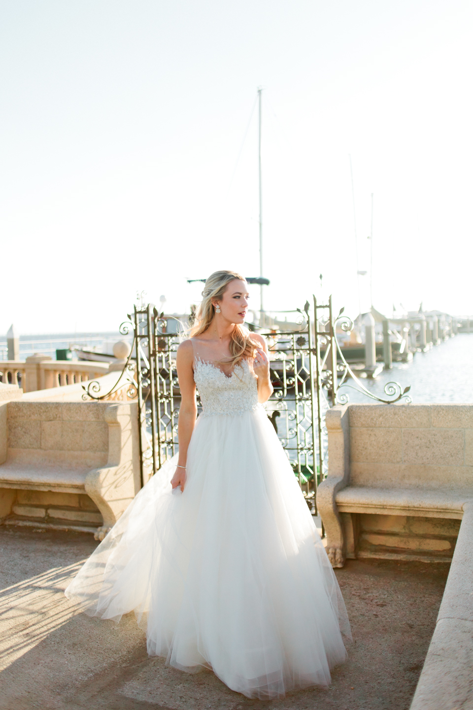Image of a bride in a Calvet Couture wedding gown at the harbor at Epping Forest Yacht Club in Jacksonville, Florida