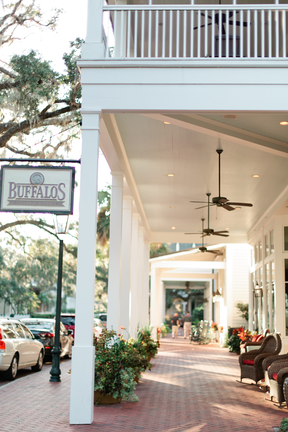 "Image of a restaurant in Montage Palmetto Bluff in coastal South Carolina.  There are rocking chairs on the front porch and a sign that says, ""Buffalo's""."