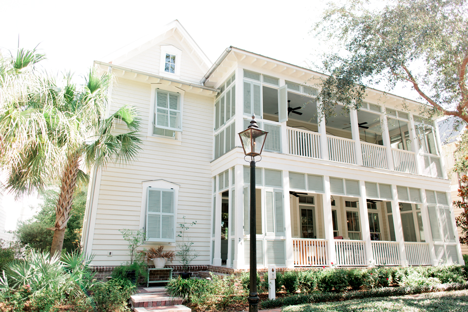 Image of a coastal South Carolina home in Montage Plametto Bluff.  It is a two-story house with porches and shutters.