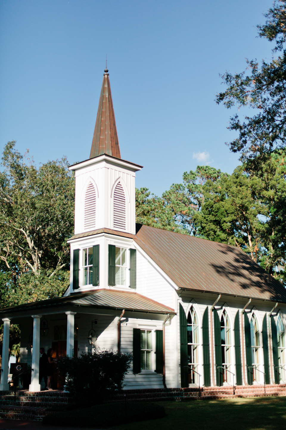 Image of a quaint white chapel with shutters in Montage Palmetto Bluff, coastal South Carolina