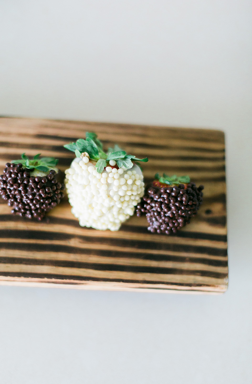 Image of chocolate covered strawberries on a wooden board at the Omni Amelia Island Plantation Resort.