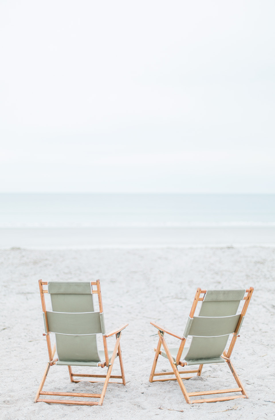 Picture of two beach chairs on white sand on the Atlantic coast at the Omni Amelia Island Plantation Resort.