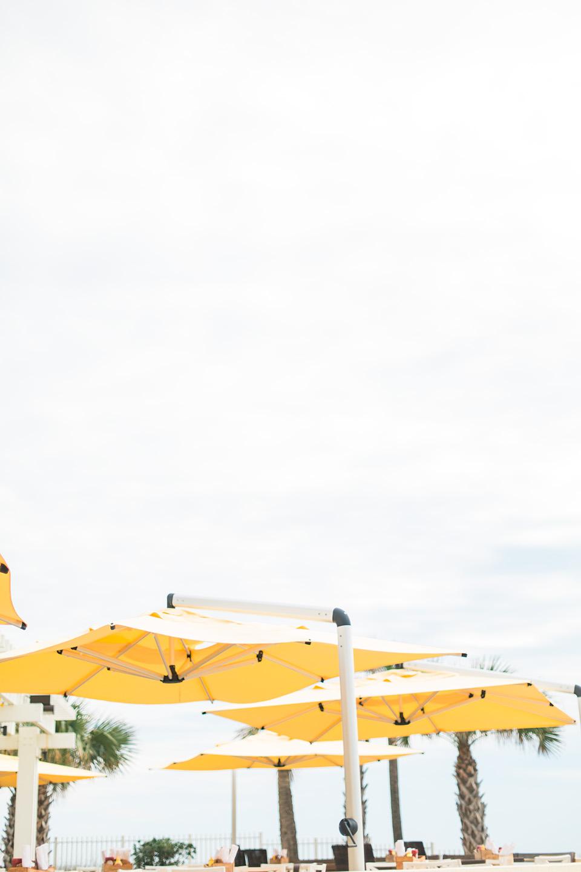 Image of bright yellow beach umbrellas at the Omni Amelia Island Plantation Resort.