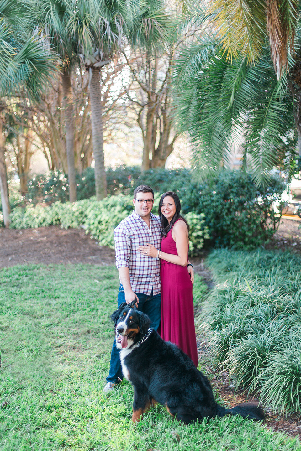 Picture of an engaged couple in downtown Orlando with their Bernese Mountain Dog.