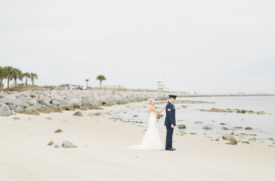 Image of a first look with a bride and groom on their wedding day.  They are on the beach in Ponce Inlet, Florida.  | Debra Eby Photography Co.