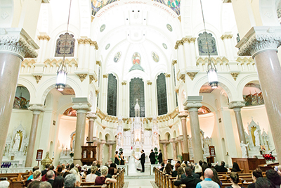 Image of a catholic wedding ceremony on a wedding day.  The couple is holding hands, they are just about to say their vows.  | Debra Eby Photography Co.