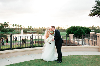 TPC Sawgrass, Ponte Vedra, Florida.  Sunset portraits on a wedding day with the bride and groom kissing. | Debra Eby Photography Co.