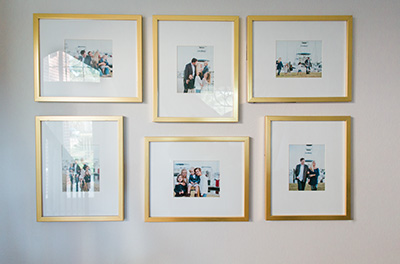 Gallery of family pictures on a wall with large matting.  Gold frames, set of six. | Debra Eby Photography Co.