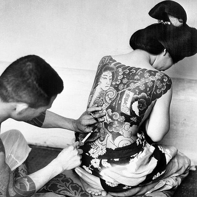 my inspiration for my signature design. this is a photo from 1954 of a womxn receiving her traditional tattoo. before meiji era in japan, womxn who were of lower class who were not allowed to wear the ornate kimonos, opted for these tats. they weren't as taboo as they became during the meiji era...& now they're still super taboo & considered yakuza as fawk.