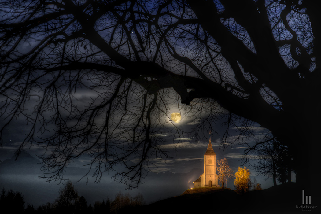 St. Primus church and supermoon above