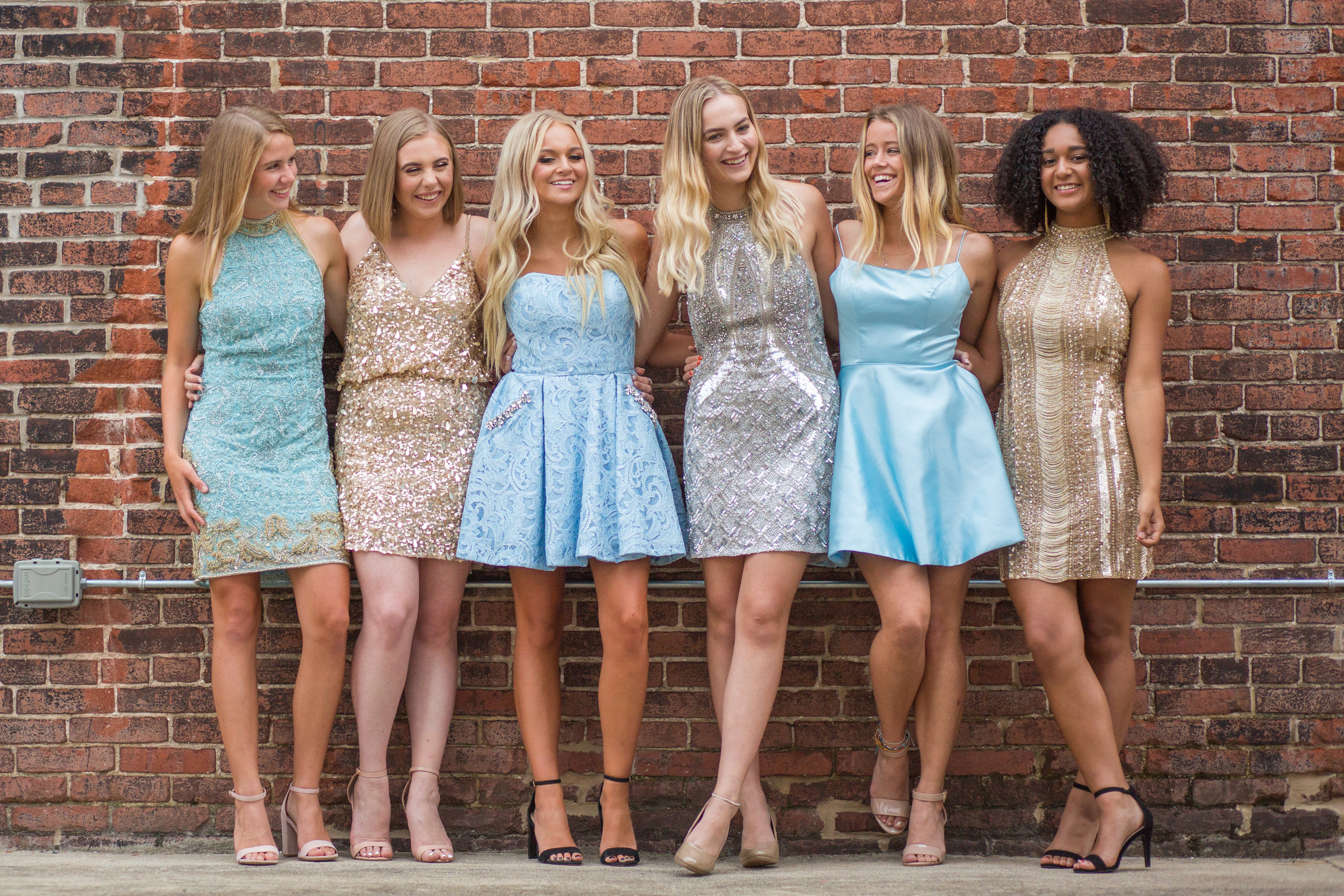 Pretty Team 20's Homecoming Photo Shoot featuring Sherri Hill dresses from J & B Bridal. Location at The Barrel House