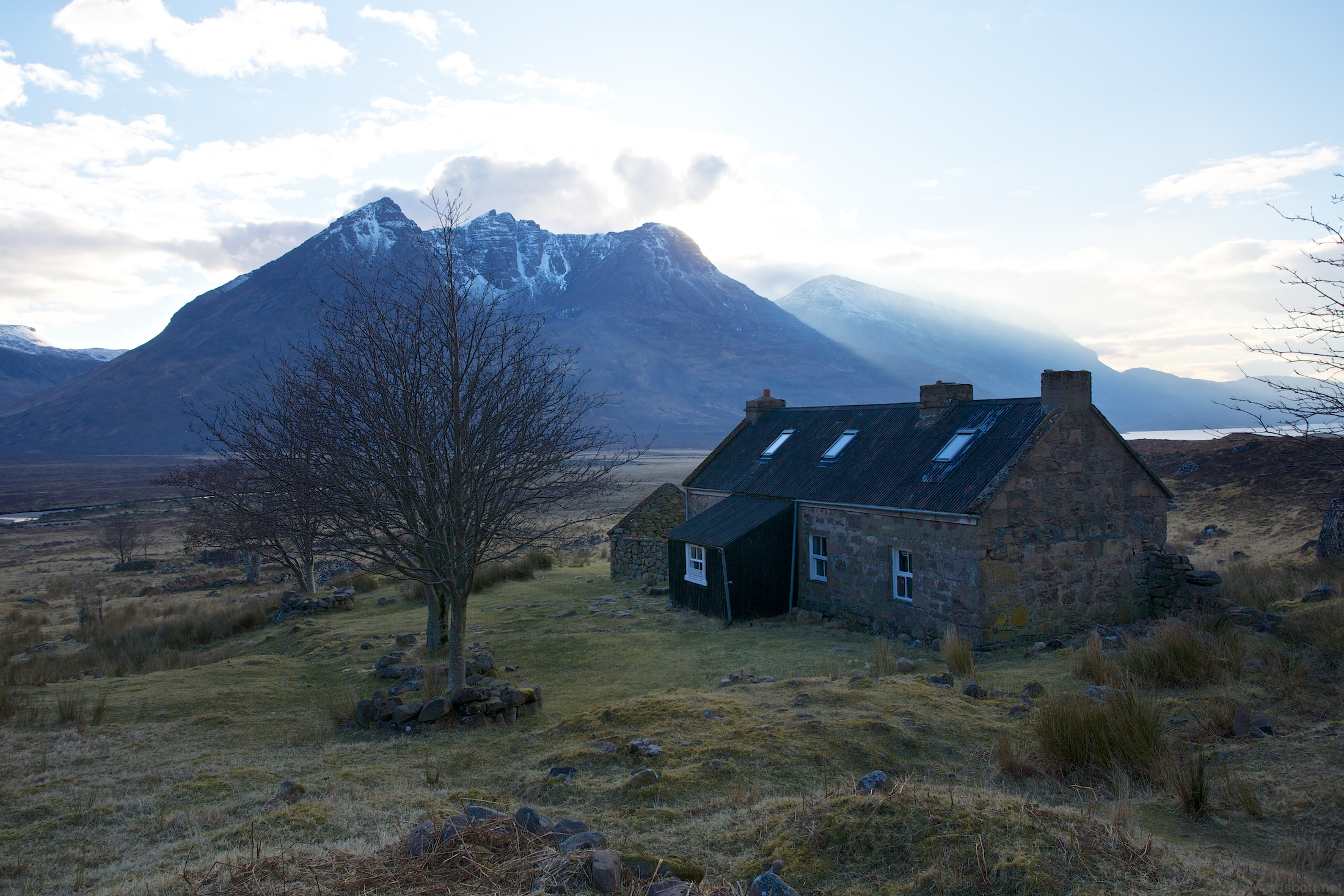 Shenavall Bothy. Facilities: roof, fireplace, spade, nearby stream. Location: priceless.