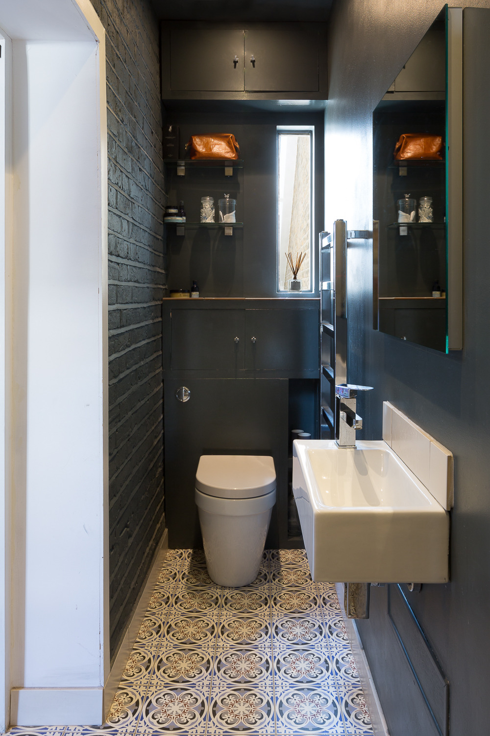 A slim ensuite bathroom that projects out into the side passageway.