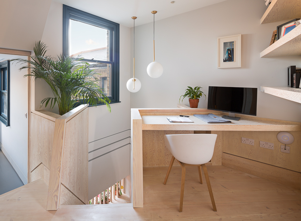 A bright workspace on the first floor landing - the landings become generous and usable spaces in the new configuration of the house