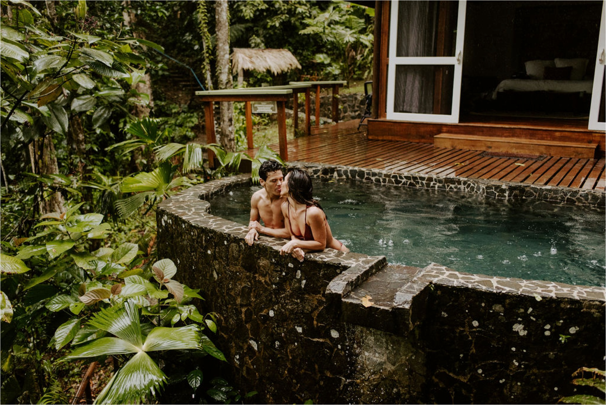 boho couple swimming elopement adventure photos pacuare lodge