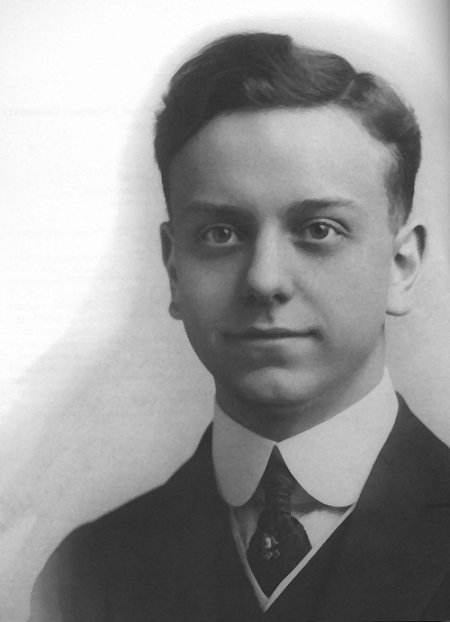 An old photo of a young Virgil Thomson with big eyes and a side-parted short wavy hairdo.