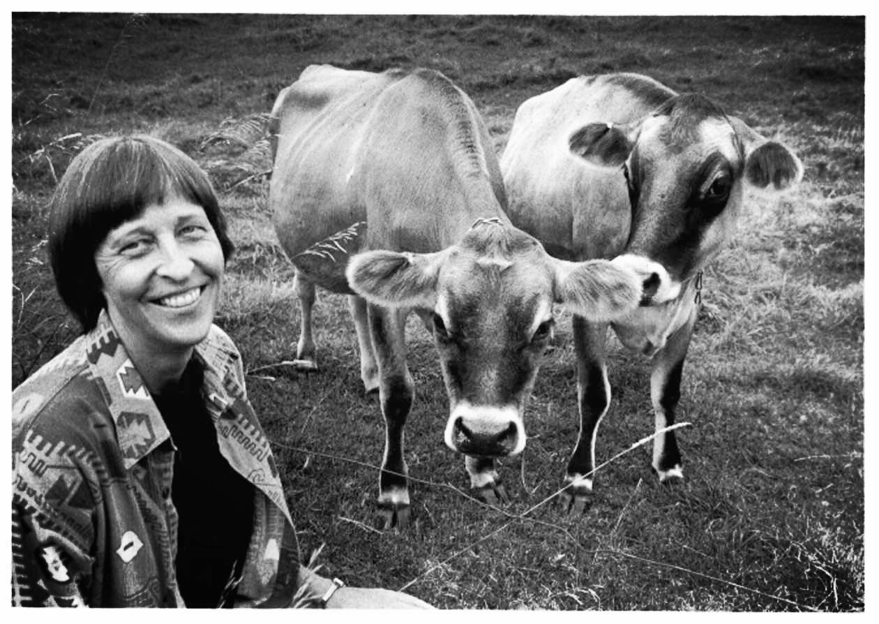 With her cows - Photo: Robert Eddy
