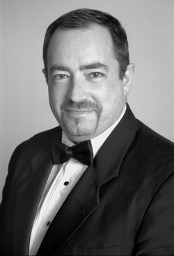 A goateed and tuxedoed Stephen Smith.