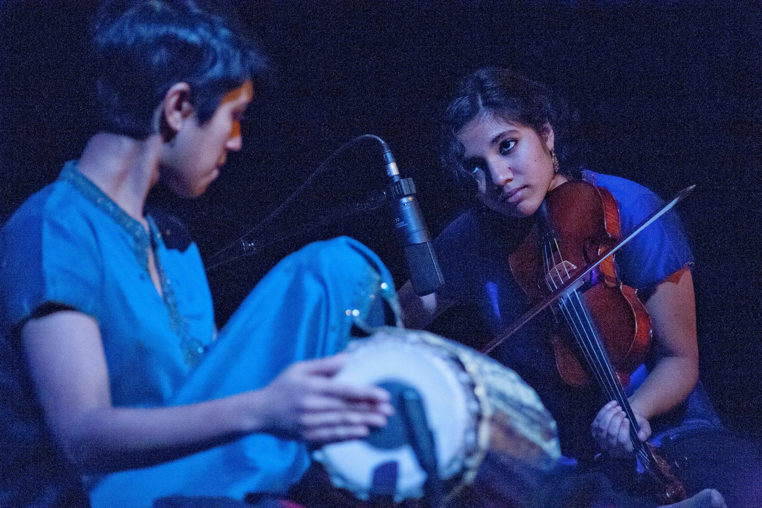 Musicians Rajna Swaminathan and Anjna Swaminathan (L-R) play mrudangam and violin respectively during Meena's Dream. Photo by C. Stanley Photography.
