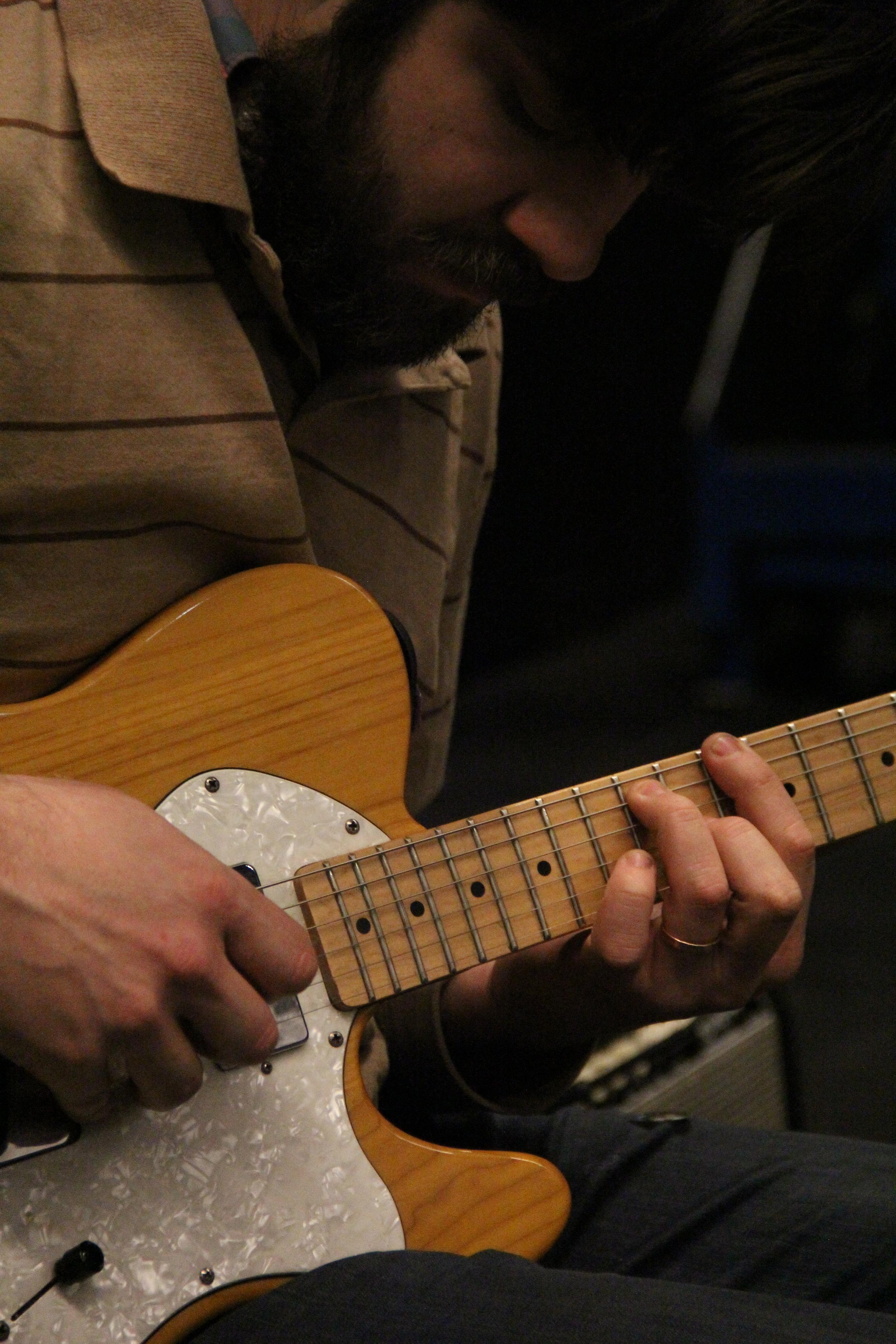 Musician Sam McCormally plays guitar during Meena's Dream. Photo by Q. Terah Jackson.