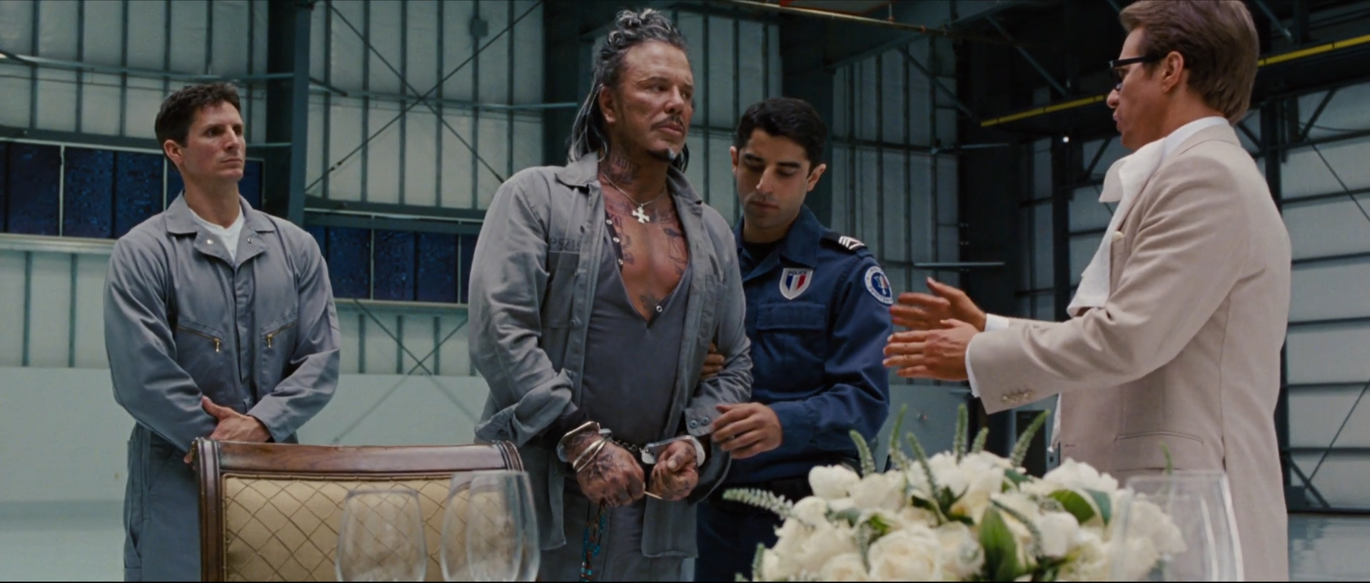 Iron Man 2  (2010): the slimy Justin Hammer (right) makes a deal with the devil, Ivan Vanko (center)