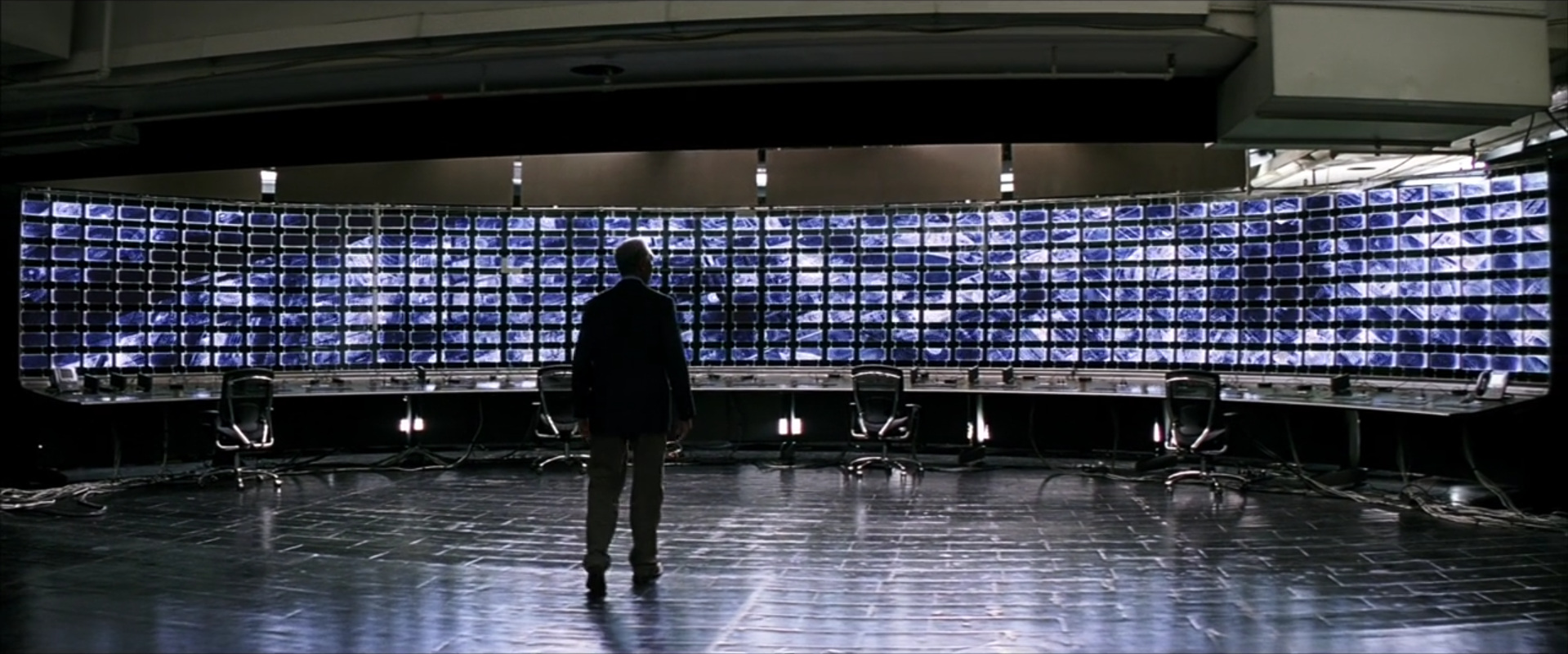 """The Dark Knight  (2008): Batman adopts the Bush administration's strategies for waging the """"global war on terror,"""" here with massive electronic eavesdropping"""