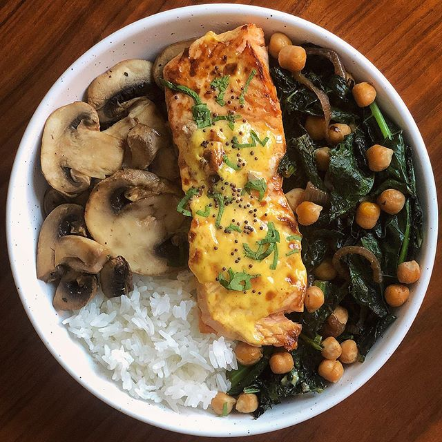 Honey Mustard Baked Salmon with sautéed kale, mushrooms, chickpeas, and rice. 🤤🤤🤤🤤 Drool-worthy and perfect for a quick weeknight dinner 5 SP for the bowl. . . . Air Fryer Honey Mustard Salmon (2 SP)  Veggies (0 SP)  Chickpeas (0 SP)  2/3 cup TJ jasmine rice (3 SP) . . This Salmon is so easy, just top a piece of fish with a honey mustard of your choice. I used @kensdressings lite Honey Mustard (2 SP) - next place this in a 350° set air fryer and cook for 10-12 minutes. That's it! I also topped my fish with chopped parsley, mustard seed, salt and pepper.