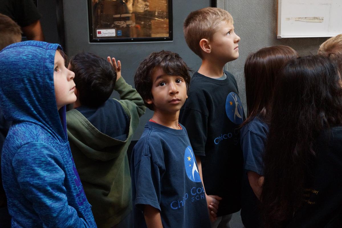 A class peeks into our ten-door cooler.