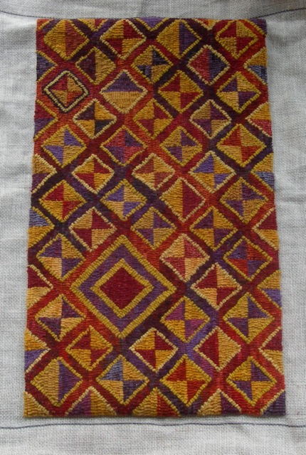 This beauty (awaiting its border) was designed and hooked by Beth Tembo. It's inspired by designs found in Kuba textiles made in Democratic Republic of the Congo (formerly Zaire).