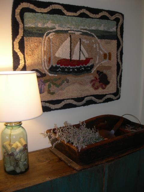 Ship in a Bottle  as it hangs in the hallway outside my studio.