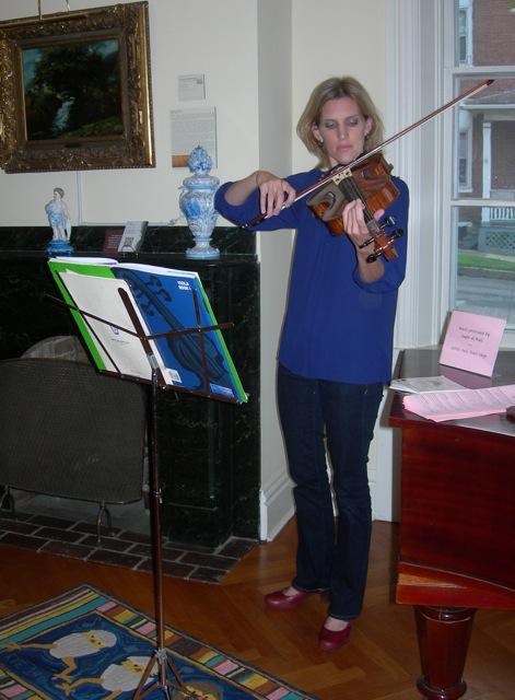 Sadie deWall of Little Owls Knit Shop serenading us.