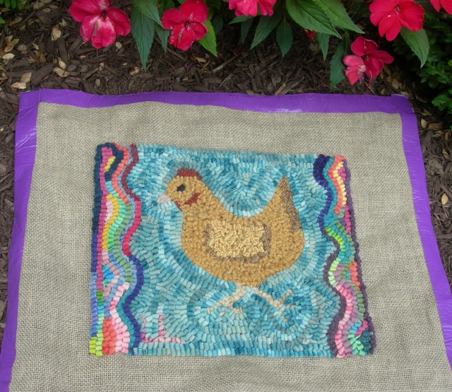 I finished hooking around Lucy's chicken. I'll make it into a pillow this week and mail it to her.