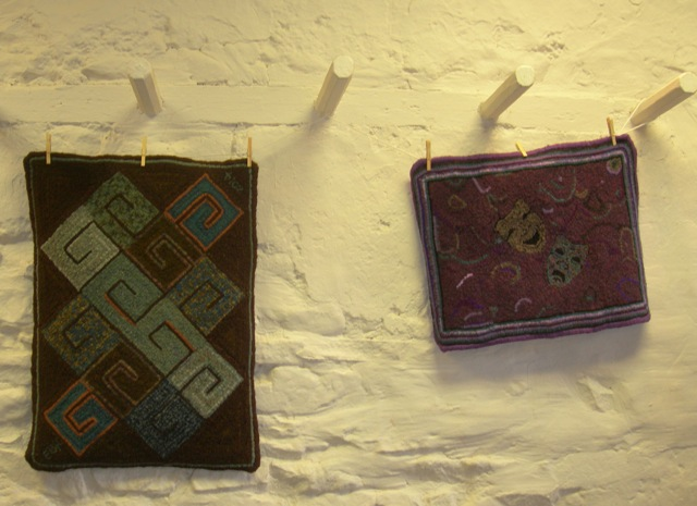 A couple of Emily's rugs on display.