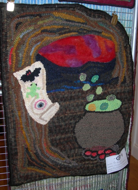 This is my pattern,  The Recipe , hooked by another rug hooker.  Fun to see hanging in the show!