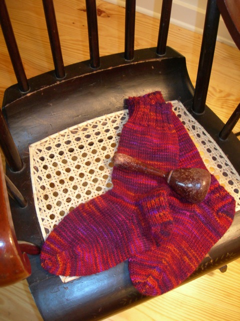 These cozy socks are ready to wear.  They're sitting on my antique ladies' rocker that I just had re-caned by  Erickson's Chair Caning.   They did a superb job!