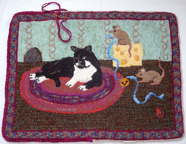 Belling the Cat  rug is almost finished.