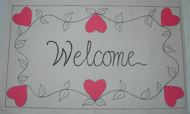 A designfor a  Hearts and Vines  welcome mat.