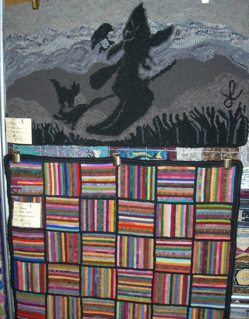 There was a rug show for the rest of us..... The top rug was designed and hooked by Linda Kerlin.  The colorful hit or miss rug was hooked by Rhonda Gillispie Bateman.