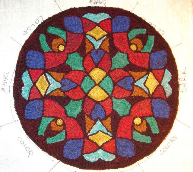 The Snowflake Mandala looks like a stained glass window. Binding to follow.