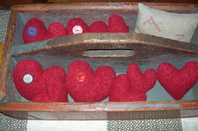 I found a red wool sweater at a thrift shop, felted it, and made these puffy hearts.