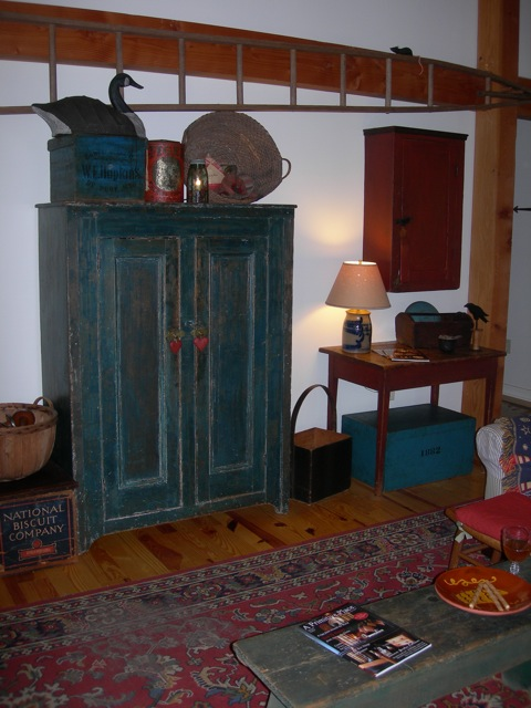 This blue linen press is one of my favorites.  The red hanging cupboard is the first prim antique that i bought back in the 80s.