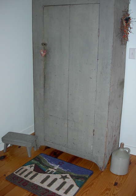 A grey cupboard in the bedroom.