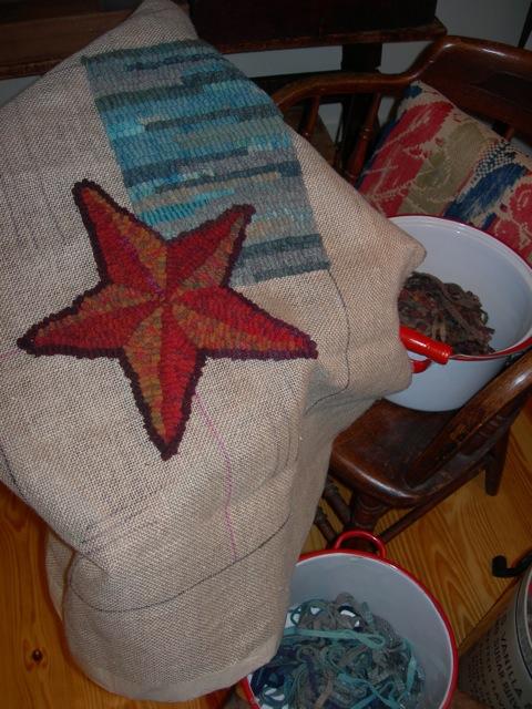 Hooking on my prim star on International Rug Hooking Day.