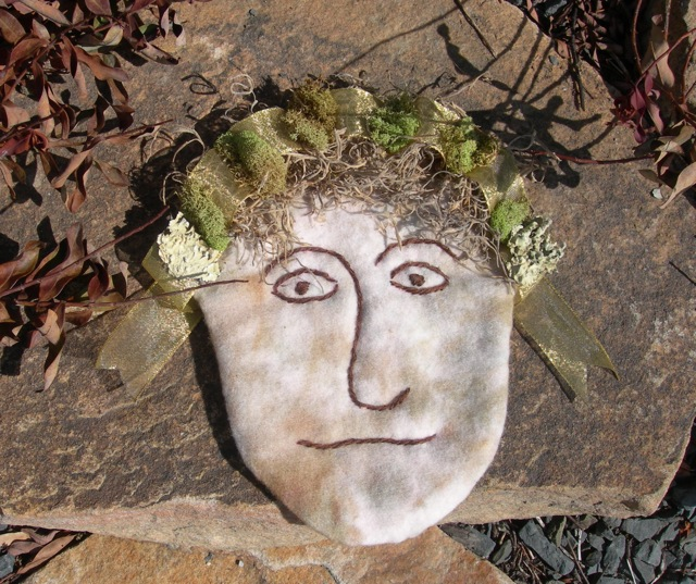 """The angel's face with a moss and lichen """"halo""""."""