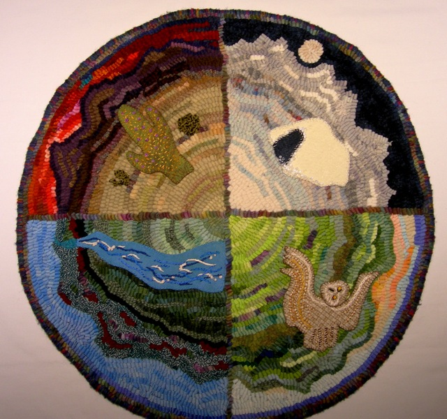 "Shamanic Directions, 24"" diameter, wool cloth strips on linen foundation with embroidered elements on each quadrant, mounted on foam core backing."